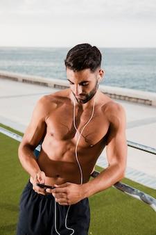 Sportive man break listening music