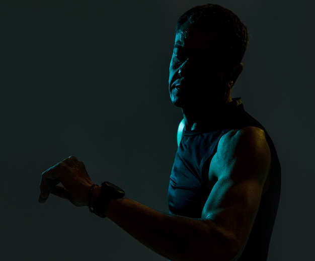 Sportive man in dark