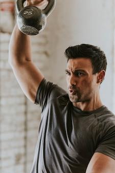 Sportive man lifting a kettlebell