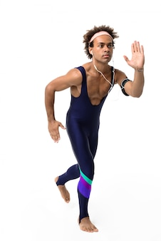 Sportive man wearing earphones running