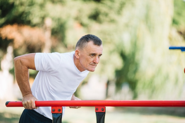 Sportive man working out outdoor