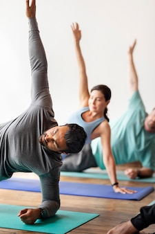 Sportive people in yoga pose
