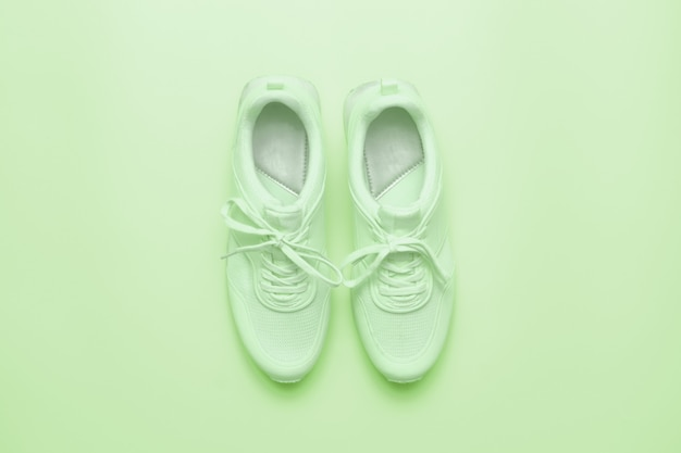 Sportive sneakers in light green color.