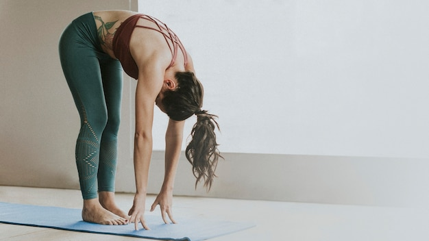 Sportive woman in pada hastasana pose