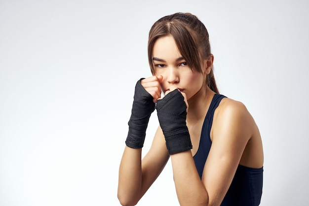 Sportive woman with bandaged hands boxing exercise workout