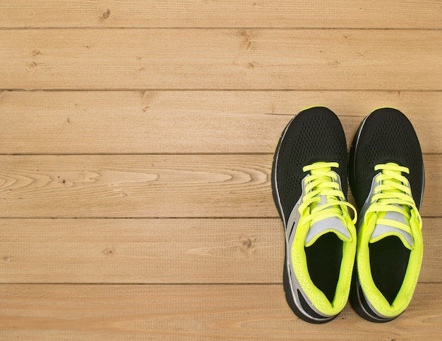 Sports accessories for fitness on the wooden floor.