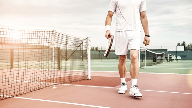 Sports build good habits confidence and discipline man stands on the court