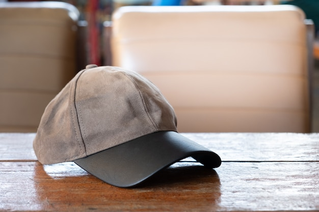 Sports cap on the old wooden table