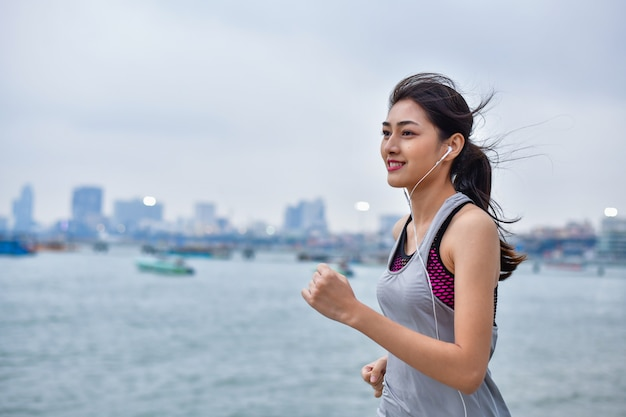 Sports concept. beautiful girl is exercising on the beach with running.