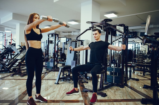 Sports couple in a morning gym