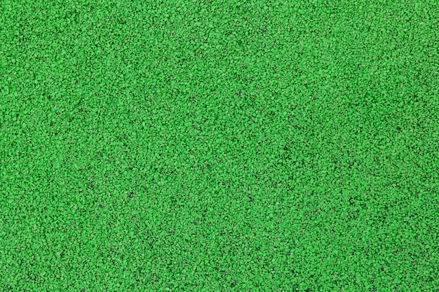 Sports court or playground background. artificial rubber coating for playgrounds and sports places in green color