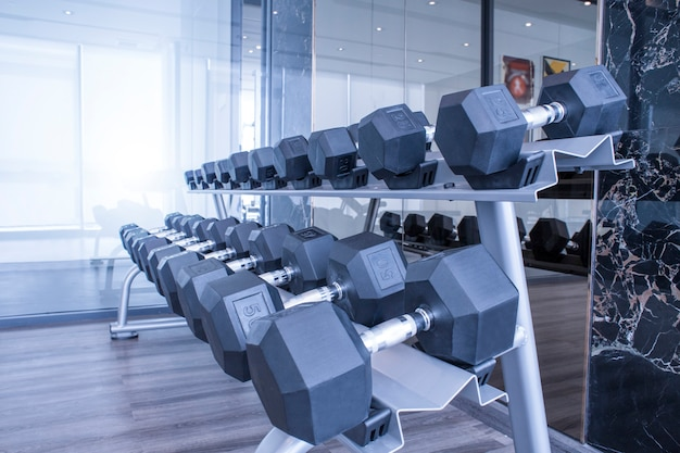 Sports dumbbells in modern sports club for a exercise in the fitness center in gym