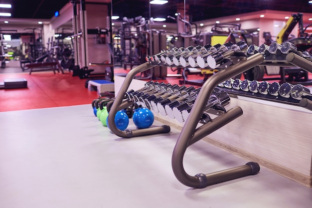 Sports dumbbells weights  in the gym interior