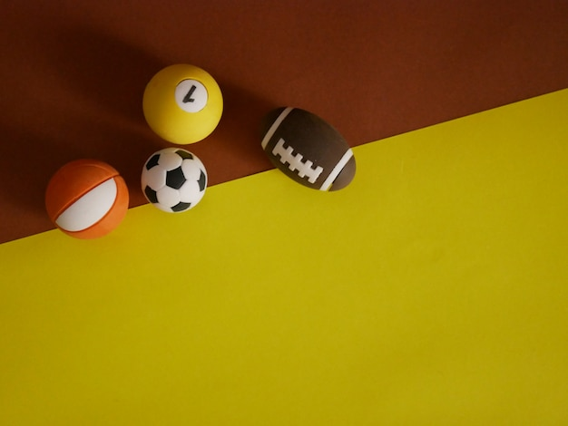 Sports equipment on brown and yellow background. top view