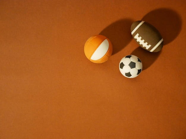 Sports equipment including a american football, soccer ball and basketball