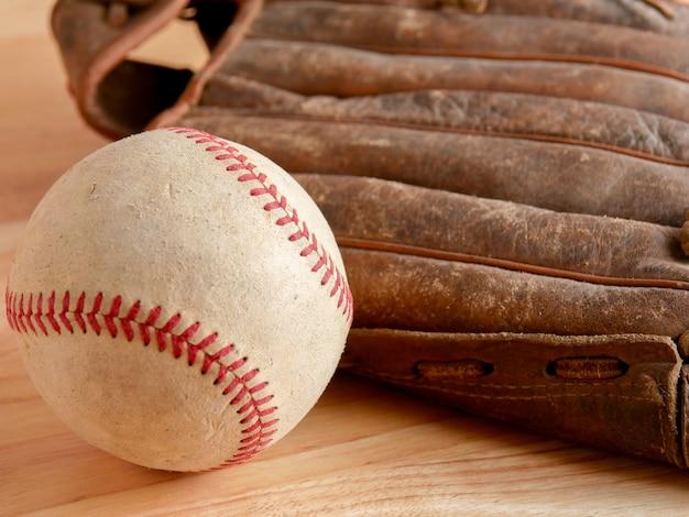 Sports equipment old baseball on wood background