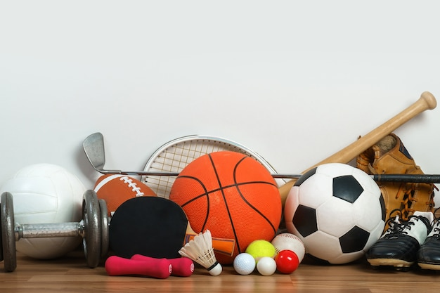 Sports equipment on wooden background