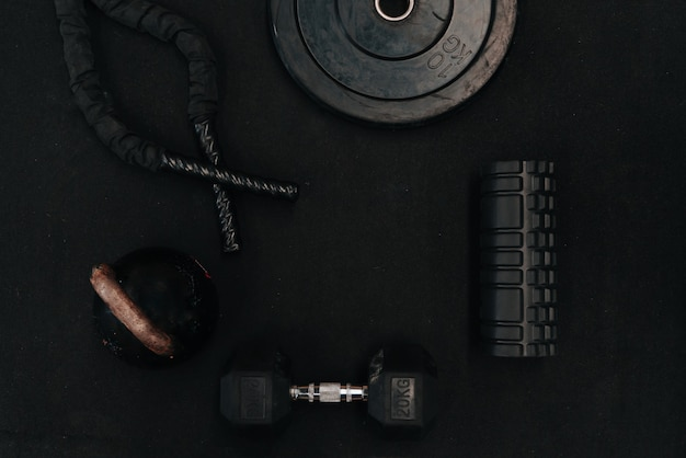 Sports exercise tool russian press, ropes, dumbbells, on a black background
