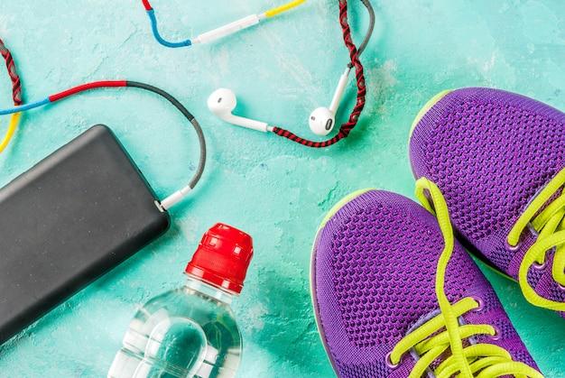 Sports, fitness concept. running sneakers, water bottle, headphones