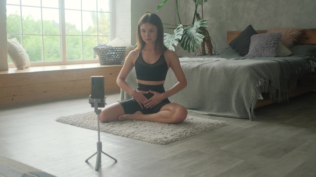 A sports girl blogger is teaching how to breathe correctly online by phone.