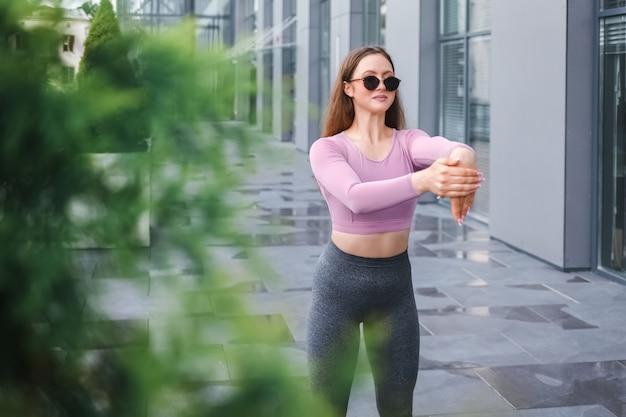 Sports girl doing morning exercises