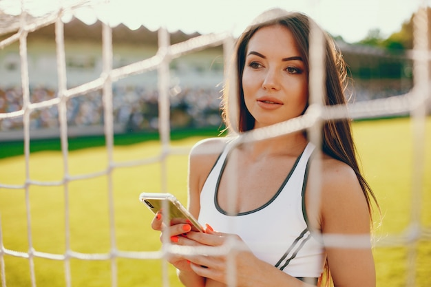 Sports girl training at the stadium
