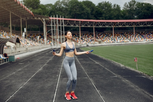 Sports girl training at the stadium