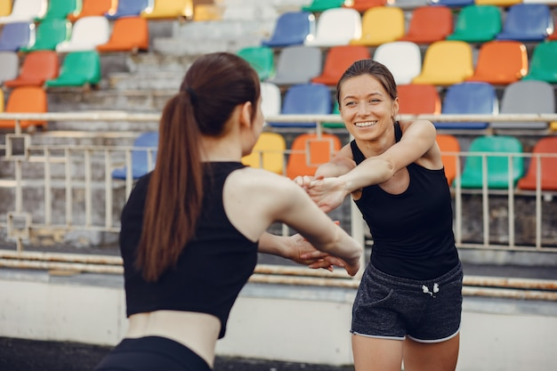 Sports girls training at the stadium