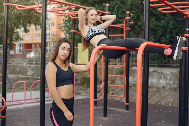 Sports girls training in a summer park