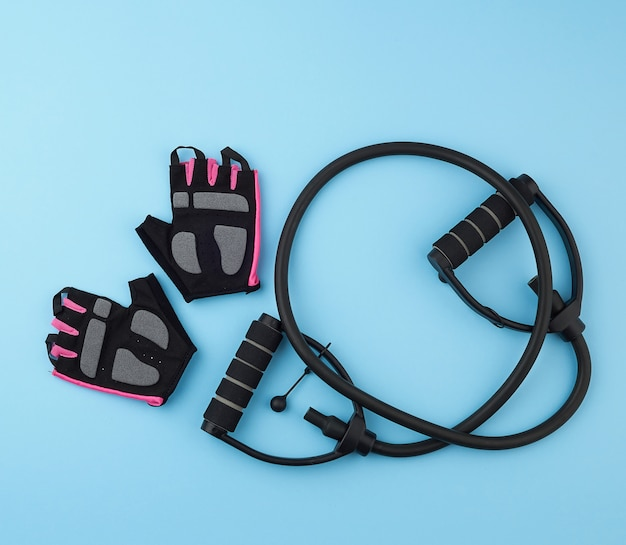 Sports gloves and rubber hand exercise machine