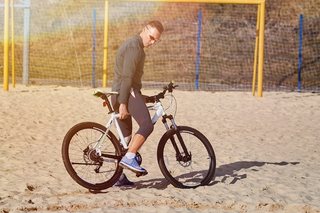 Sports man on a bicycle