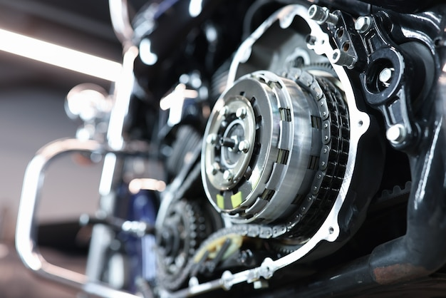 Sports motorcycle engine in service center disassembly and repair of engines concept