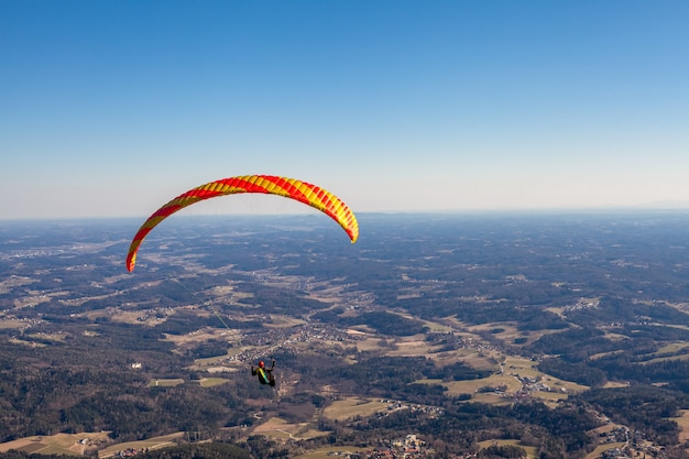 Sports paragliding on a parachute over the countryside