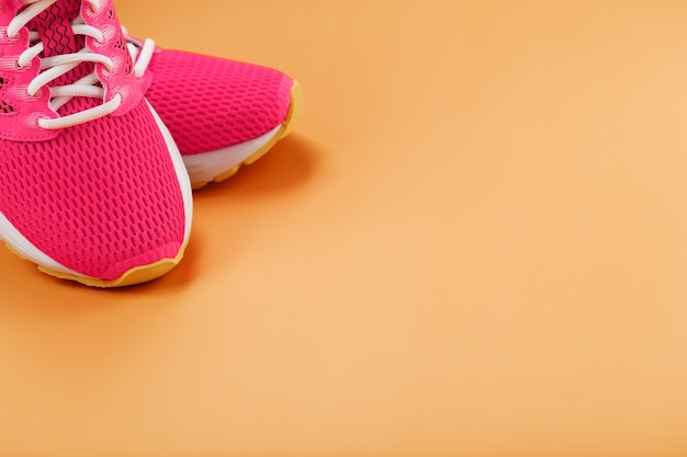 Sports sneakers isolated on orange
