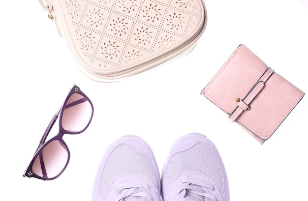 Sports sneakers, leather wallet, bag, sunglasses isolated