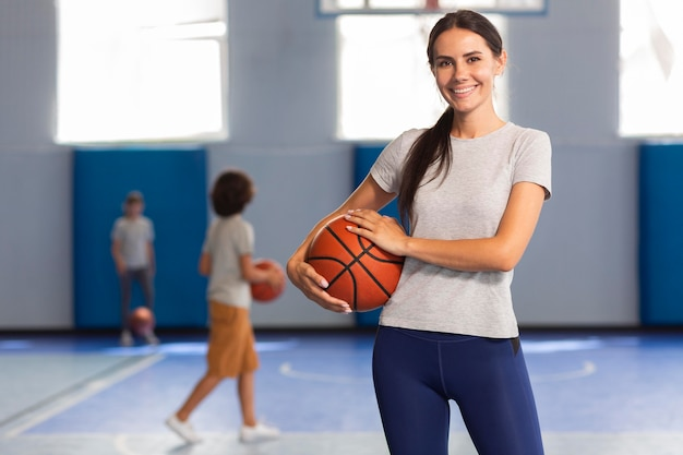 Sports teacher in gym class