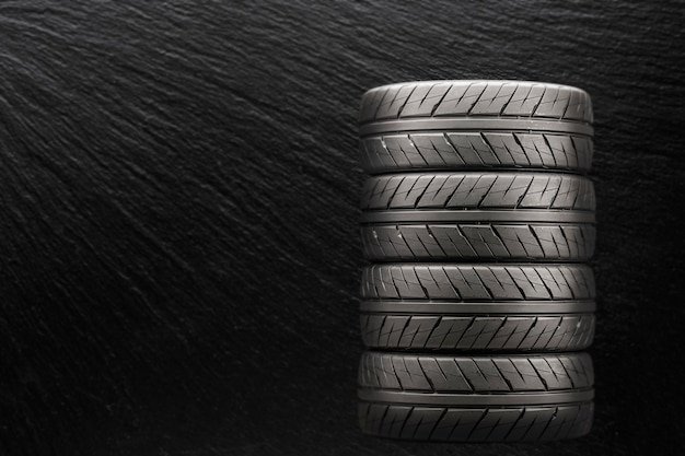 Sports tires on a black blurry background.