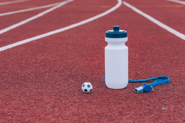 Sports water bottle with whistle and ball