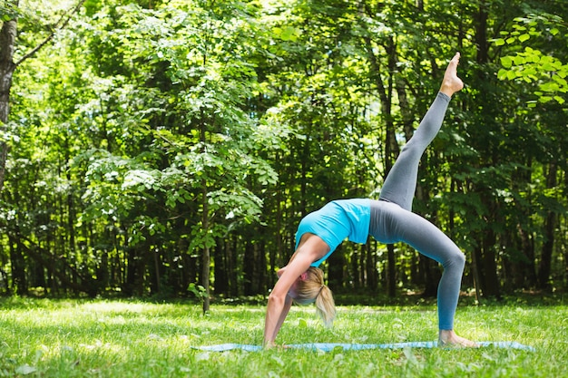 Sports woman doing yoga on outdoor.
