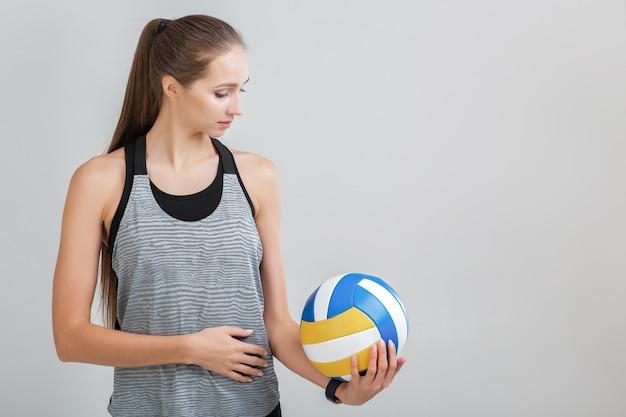배구를 들고 스포츠 여자