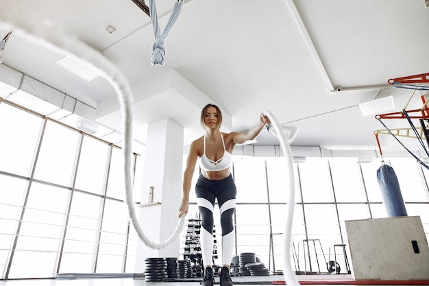 Sports woman training in a morning gym