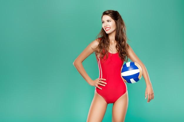 Sports woman with volleyball