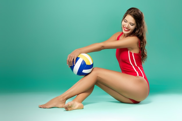 Sports woman with volleyball Premium Photo