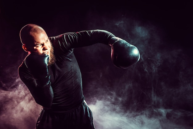 Sportsman boxer fighting with smoke