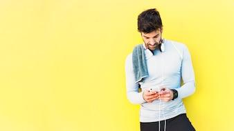 Sportsman browsing smartphone