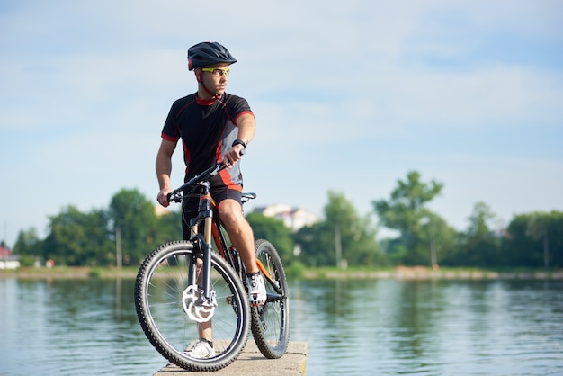 Sportsman cycling on bicycle outdoor