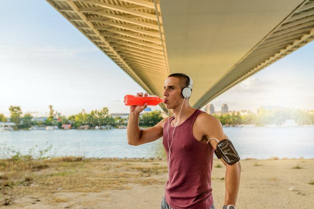 Sportsman drinks water