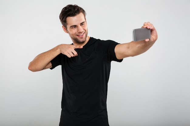 Sportsman make selfie by mobile phone pointing.