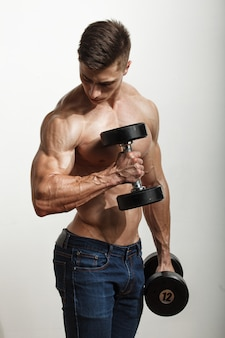 Sportsman performing exercises with dumbbells