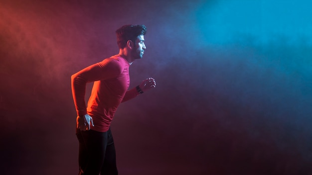 Sportsman running in dark smoke